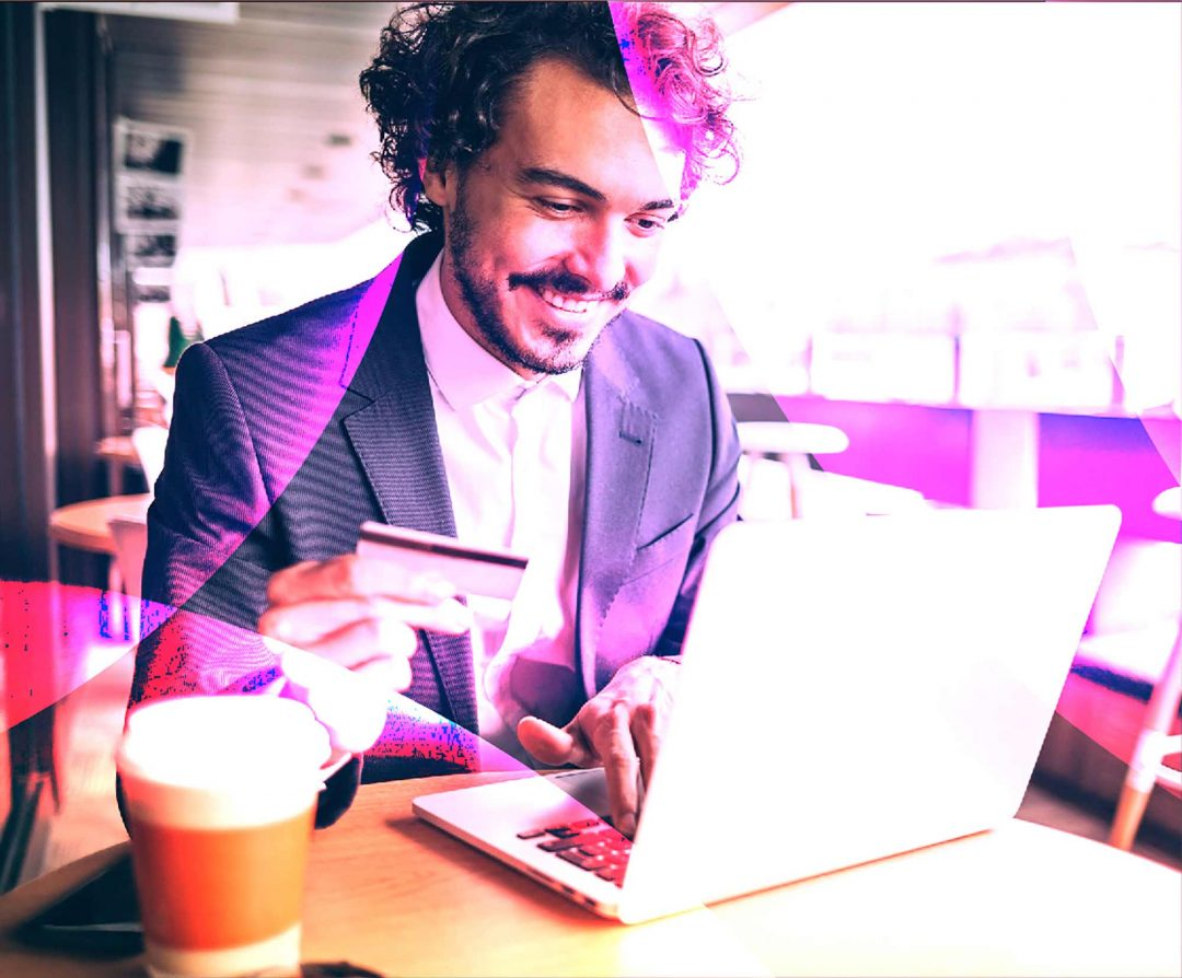 new website viewed by a man in suit holding credit card